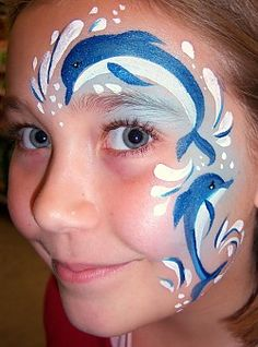 Dolphin face paint design for an outdoor movie party - Southern Outdoor Cinema expert tip for theming and enhancing an outdoor movie event.