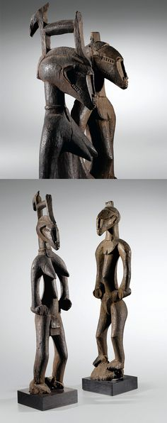 Africa | Primordial couple from the Senufo people of the Ivory Coast | Wood; the deep erosion of the base - stuck in the ground in the initiation enclosure - attests to their very long use. | ca. 1st half of the 20th century, or earlier
