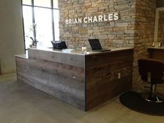 Brian Charles Salon used barn siding for their receptionist desk. A perfect look for their entry into the salon.