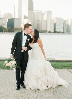 Gorgeous blush ruffled train wedding dress: http://www.stylemepretty.com/2016/01/22/elegant-chicago-wedding-with-an-amazing-donut-wall/ | Photography: Britta Marie - http://brittamariephotography.com/