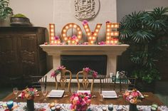 Marquee letters, usually spelling LOVE, like this, are a hot trend (tip - if you need them, check amazon) ~ http://ruffledblog.com/contemporary-la-jolla-wedding/