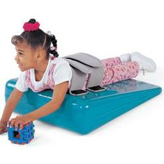 This wedge includes two straps to provide gentle yet firm support, and to secure the child in stable position. The wedge will enhance the child's availability to floor activity participation.