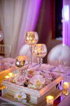 Cracked glass goblets and photo frame, tealights and flowers