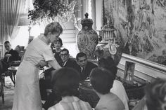 Marjorie Merriweather Post showing students her collection...the urn in the background matches mine which came from a great mansion in St Louis