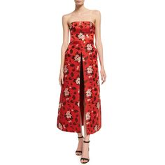 --evaChic--This Alice + Olivia Jeri Strapless Floral-Print Overskirt Romper from FW17 is a statement single-piece evening look featuring a chic floral motif, an overskirt with front slit, and a bustier-like bodice. This romper doubles as an evening gown offering an avant-garde silhouette with a younger feel.    https://www.evachic.com/product/alice-olivia-jeri-strapless-floral-print-overskirt-romper/
