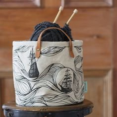 fabric buckets for storing in-progress knitting projects.