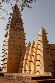 Bobo-Dioulasso, Burkina Faso. Looks like those wooden sticks protruding out of the wall make a perfect stair for kids.