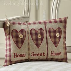 This is a decorative motif padded cushion which has hearts, buttons and slogan home sweet home. The will be a perfect gift for a country home.