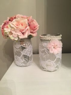 Pretty centerpiece or favor Mason jar with lace and pearl trim. I Made these from an idea I saw, im making several as centerpieces for my daughters communion party. I may light them with tea lights Tea Party Centerpieces, Communion Centerpieces, Pearl Centerpiece, Mason Jar Centerpieces, Christening Party Favors, Communion Party Favors, First Communion Party, Pearl Bridal Shower, Bridal Shower Cakes