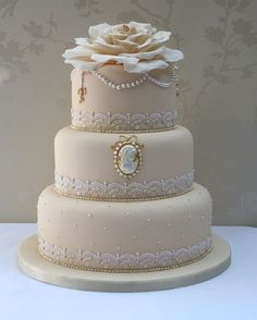 Lovely taupe cake with cameo, lace and pearl detail. Beautiful! ᘡղᘠ