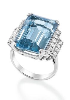 An Art Deco aquamarine and diamond ring, c. 1930  The cut-cornered rectangular-cut aquamarine claw-set to stepped circular-cut diamond shoulders