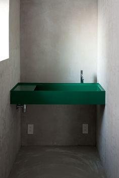 The coolest dark green sink. Looks great with all the concrete in this modern bathroom. Naked house, Apartment renovation, Tokyo | Teruhiro Yanagihara /