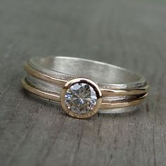 Asymmetrical Moissanite Ring - Recycled 14k Yellow Gold and Recycled Sterling Silver Ring Wedding / Engagement / Anniversary - Made to Order by McFarlandDesigns on Etsy https://www.etsy.com/listing/80535530/asymmetrical-moissanite-ring-recycled
