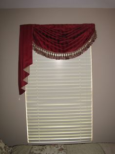 This easy to sew swag and jabot adds a touch of elegance to this single window.  Gorgeous taupe and red trim finishes the look.