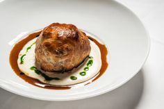beef wellington: filet mignon, mushroom duxelles, bordelaise, brie fondue, puff pastry