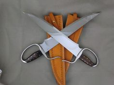Recurve Stabber Butterfly Swords with compound grind.