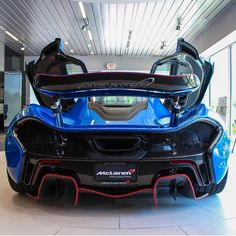 McLaren P1 painted in MSO Blue w/ red accents and exposed carbon fiber  Photo taken by: @h_hunt on Instagram
