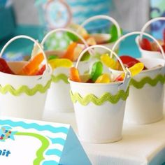 Cute buckets decorated with ric rac. white pails found at dollar tree as wedding favors.