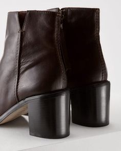 Made in Italy from buttery soft leather, these ankle boots feature a block heel…