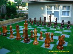 Install a giant chess board outside! It doesn't have to be black and white. In fact, it can be made with squares of greenery (think grass or even ivy or thyme) and concrete pavers. Size it at 8x8 squares so it funcitons as a board when necessary. And when it's not being used for a game, it will make a really nice-looking patio!    The game pieces shown are from GiantChess.com, but you can also invite friends over to play a game with live figures!