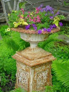 love old garden urns filled with flowers....