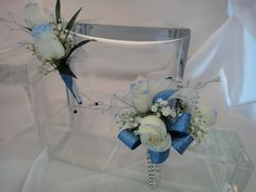 Prom Flower Set. Wrist corsage and boutonniere with white spray roses tipped in light blue with teal blue ribbon.  expressions24-7.com