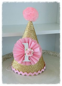 Gorgeous little party hat was made from gold glittered paper. It as been decorated with a fluffy crepe paper medallion with a number and a paper rose. First Birthday Hats, Birthday Party Hats, Elmo Party, 1st Birthday Girls, Diy Birthday, Mickey Party, Dinosaur Party, Dinosaur Birthday, Glitter Birthday Parties