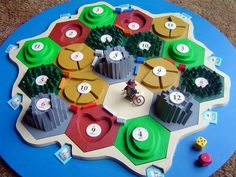 Custom 3D Settlers of Catan board from scrap plywood. I love the Indiana Jones lego doll. :)