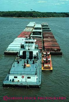a tugboat pulling out a barge