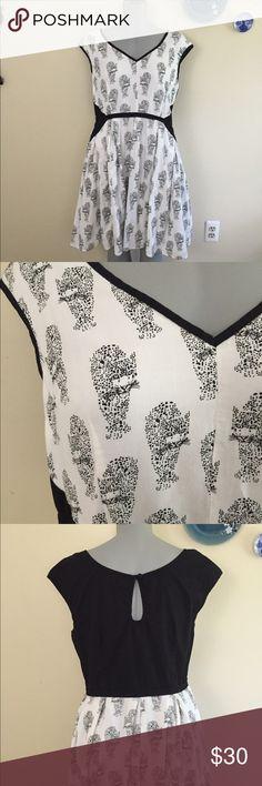 Unique, leopard print, full skirt dress. Plus size Full skirt, full lining, full leopard print. 100% cotton. Side zip. Pockets. Knee length for 5'3. Flat measurement - bust=20, waist=17, shoulder to hem=39. eshakti Dresses Midi