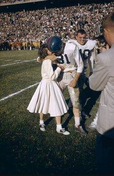 vintagesportspictures: A victorious University of Mississippi player being kissed by a cheerleader after the Cotton Bowl (1956)