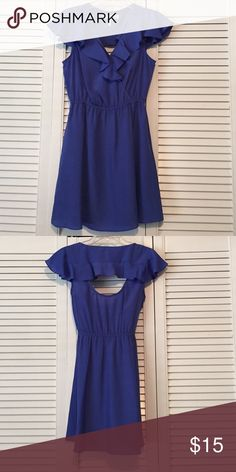 Blue sundress Blue sundress with cute open back. Discreet pockets. Loose ruffle like sleeves and ruffle around the top. BCBGeneration Dresses Mini