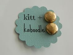 1 Pair Fabric Covered Button Earrings in Distressed Metallic Gold. $4.25, via Etsy.