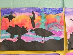 Dinosaur Cut-Outs on watercolor background