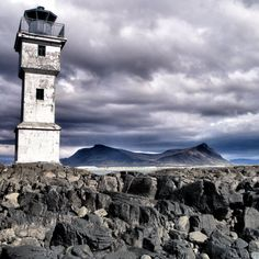 Akranes lighthouse  This old lighthouse is set in the volcanic landscape of Iceland near Akranes, the country's 9th most populous town. Almost all inhabitants of Iceland live on the coast, due the mountainous lava desert and glacial terrain of the interior.