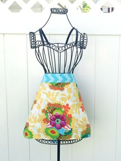 DIY apron uses just half a yard of fabric with an additional quarter yard for the ties, it is budget-friendly