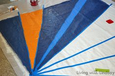 How to Make a Rug from a Canvas Drop Cloth - I was just telling Jeff that I wanted a colorful rug!