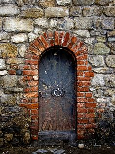 Locked  ~  Ancient portal with metal trim.  Love the red brick archway outlining the door.