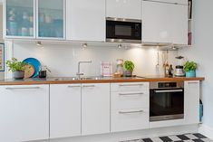 Simply Interior Decoration Ideas for Scandinavian Style Kitchen with White Kitchen Cabinets feat Wooden Countertop and Modern Electric Range plus Stainless Steel Kitchen Sink and Modern Faucet Scandinavian Style Home, Scandinavian Apartment, Scandinavian Interior Design, Scandinavian Kitchen, Apartment Interior Design, Kitchen Interior, White Kitchen Cabinets, Kitchen Cabinet Design, Kitchen Sink