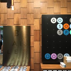 PHOTO 8: The wood tiles placed vertically add depth and interest to the wall space at this Bailey Nelson store.