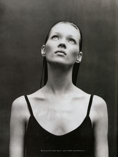 Kate Moss. Black and white. Looking up. Beautiful cheekbones.