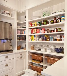 Open vegetable bins, open storage and an ice maker! Love this pantry!