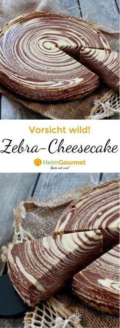 Marmorkuchen war gestern, hier kommt der neue Star im Streifenlook: Zebra-Cheesecake! Wir zeigen euch, wie er gelingt!