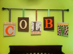 Scrapbook paper Mod Podge, ribbon, fabric, staplegun, canvases and a curtain rod...cuteness! by carlani