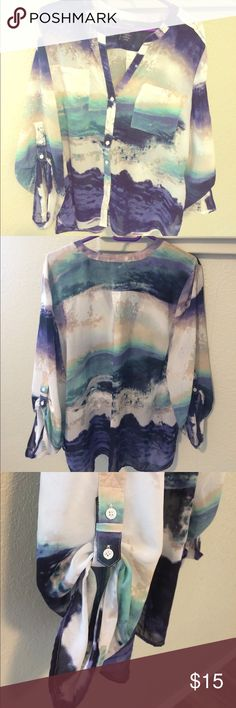 Covington button up blouse with 2 front pockets Button up blouse with 2 buttoned front pockets and button detail in sleeves. Has a galaxy look to it with the blended colors of turquoise, blue, tan, purple and white. Covington Tops Button Down Shirts