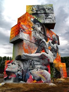 Strikingly Bold Mural Painted Across Enormous Stack of Shipping Crates - by Street artists Pichi & Avo (http://www.pichiavo.com/) as part of this year's Rock Werchter Music festival in Belgium.