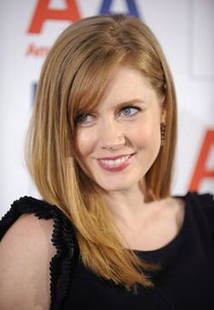 Amy Adams- Dark strawberry blonde, very nice. This is what color I want to dye my hair!
