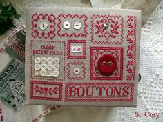 Boîte à boutons.. cartonnage brodé