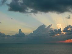 ❕ Sun covered with clouds over sea - get this free picture at Avopix.com    📷 https://avopix.com/photo/48108-sun-covered-with-clouds-over-sea    #atmosphere #sky #sun #clouds #sunset #avopix #free #photos #public #domain