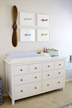 The fabulous thing about decorating the nursery - it doesn't have to be child-like.  BTW - like the changing table? it's a dresser from IKEA!     via http://projectnursery.com